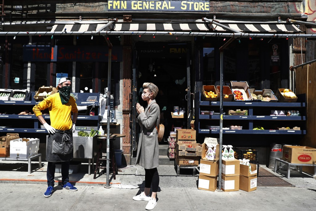 FMN General Store managing partner Derek Tigue, left, talks with neighbor Geraldine Johns in front of the former Forgtmenot bar, which his partners an...