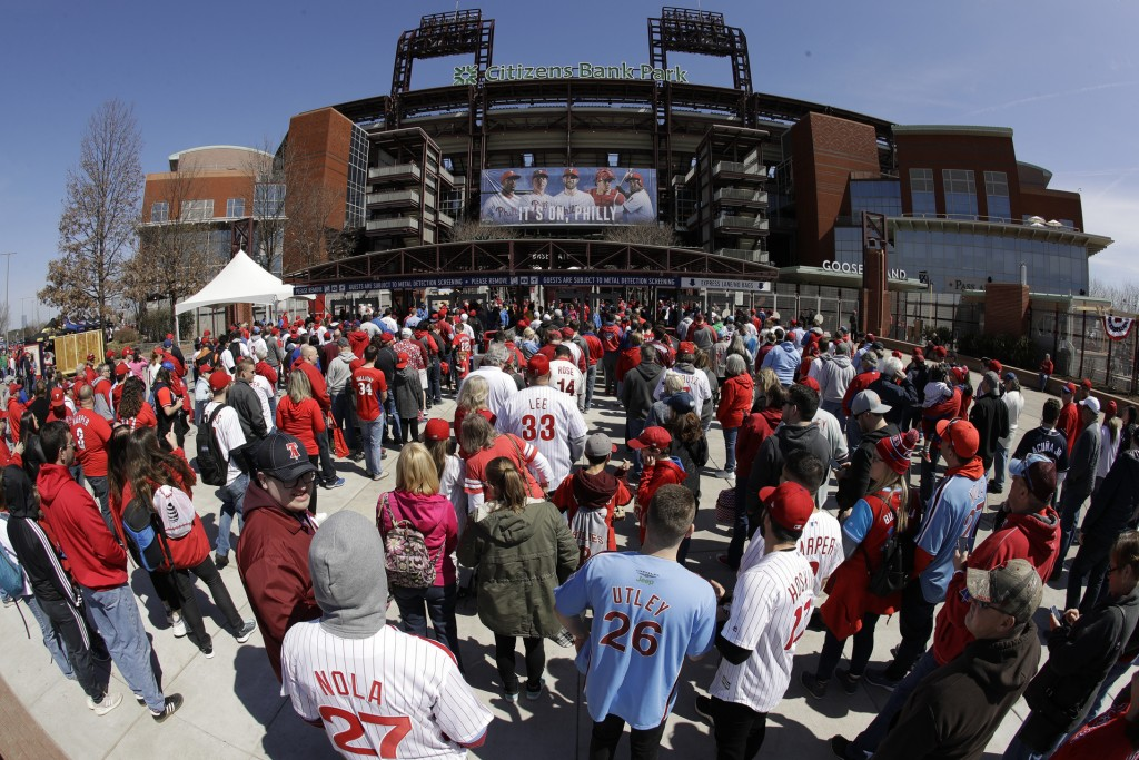 FILE - In this March 28, 2019, file photo, fans gather for the Philadelphia Phillies opening day baseball game against the Atlanta Braves at Citizens ...