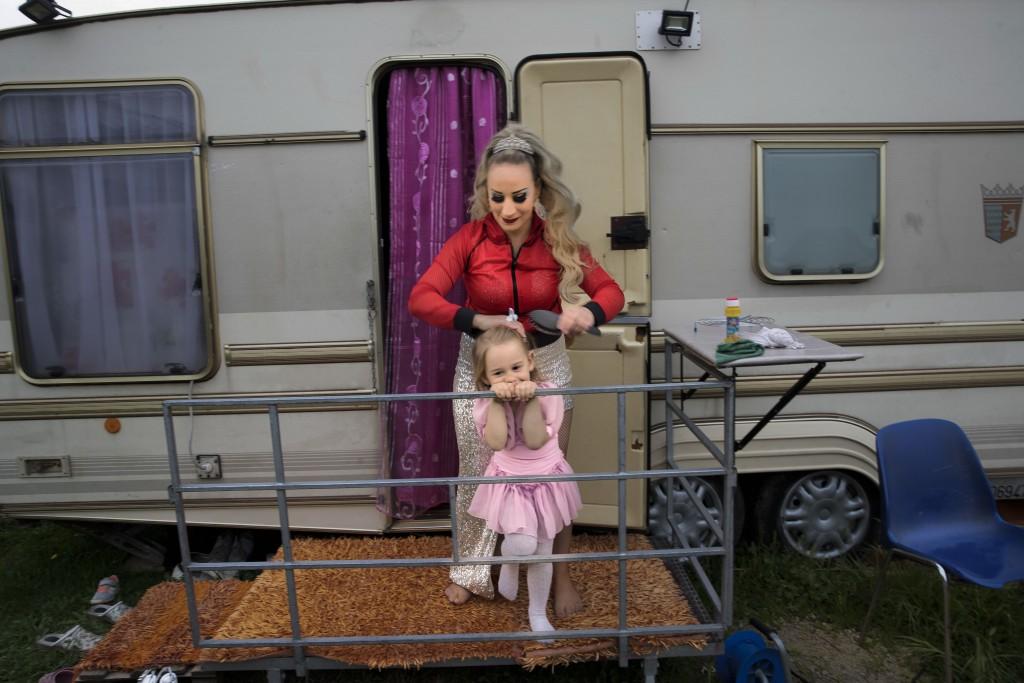 Anamaria Bud brushes her daughter Maria Cristina outside her caravan at Romina Orfei Circus, parked in San Nicola la Strada, near Naples, Italy, Sunda...