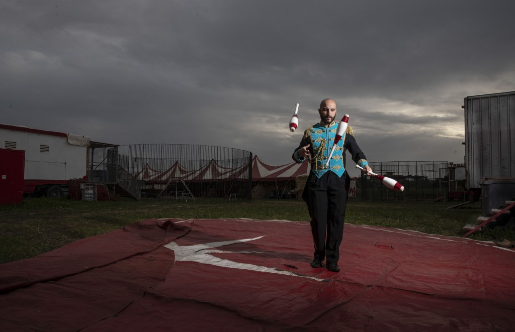 """Clown and juggler Daniel Aanitei poses for a portrait in the Rony Roller circus parked in the outskirts of Rome, Saturday, April 18, 2020. """"I am the c..."""