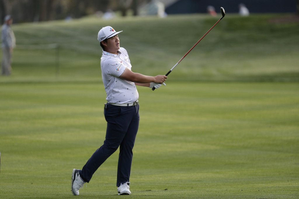 FILE - In this March 12, 2020, file photo, Sungjae Im, of South Korea, hits from the 11 fairway during the first round of The Players Championship gol...
