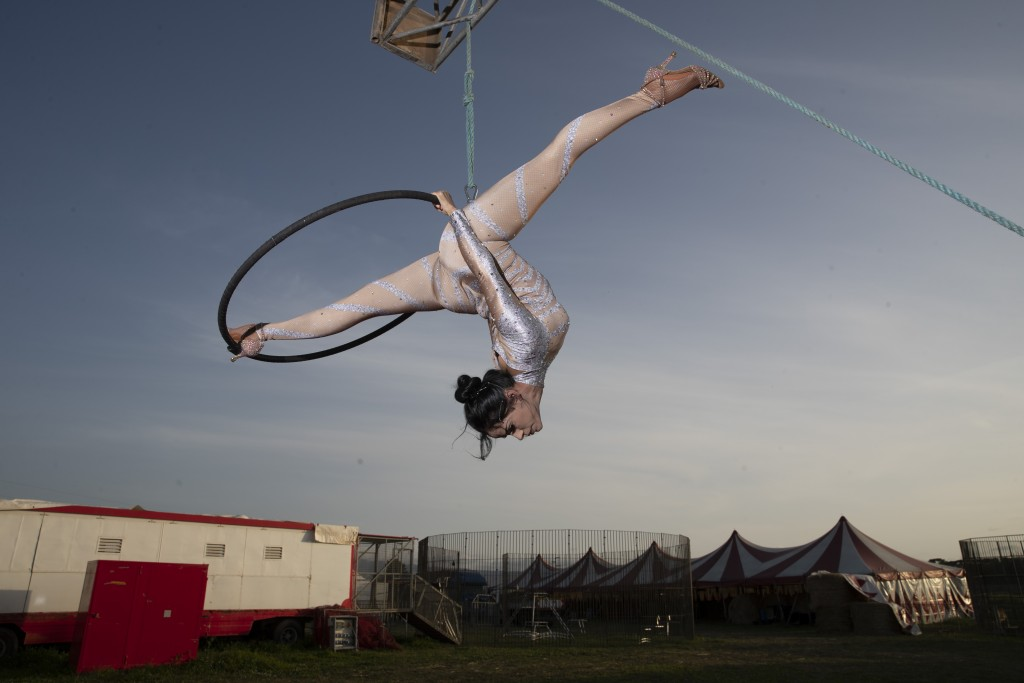 Otilia Maria Martinez Dos Santos, an artist of Portuguese origins, performs at the Rony Roller circus parked on the outskirts of Rome, Friday, April 1...