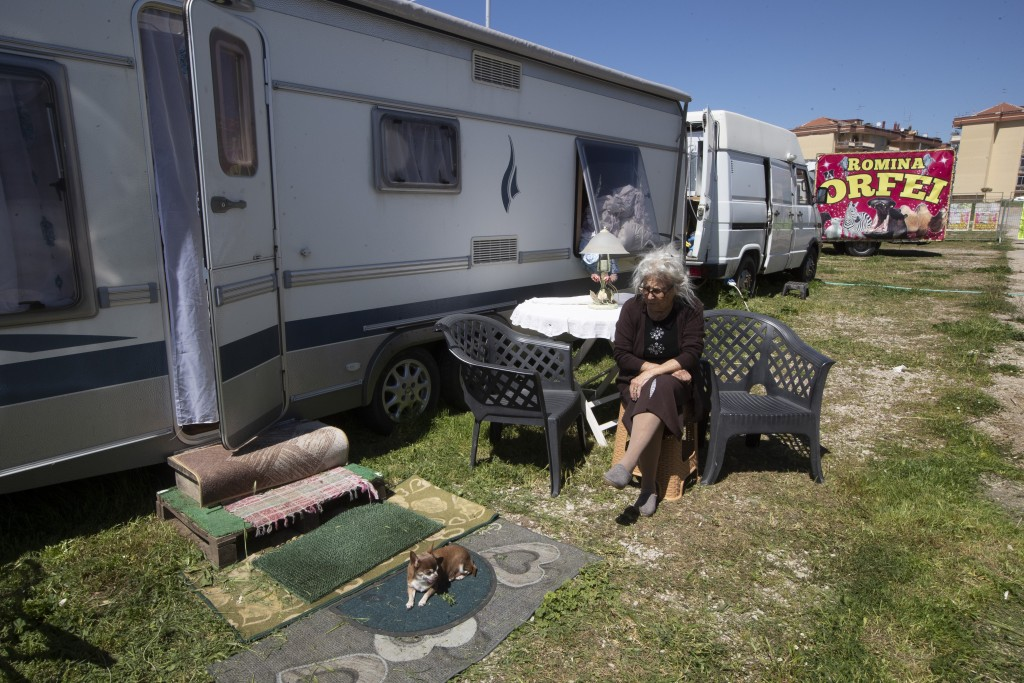 Carmela Ukmar, 85, former acrobat, mother of Romina Orfei sits outside her mobile home parked in San Nicola la Strada, near Naples, Italy, Wednesday, ...