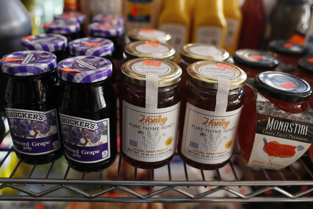 Fruit preserves and thyme honey sit on a shelf for sale at FMN General Store, formerly the Forgtmenot bar, which was converted by its owners into a mi...