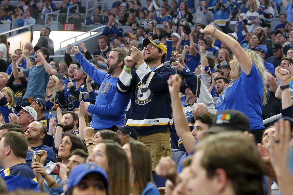 FILE - In this June 12, 2019, file photo, St. Louis Blues fans cheer as they watch television coverage of Game 7 of the team's NHL hockey Stanley Cup ...