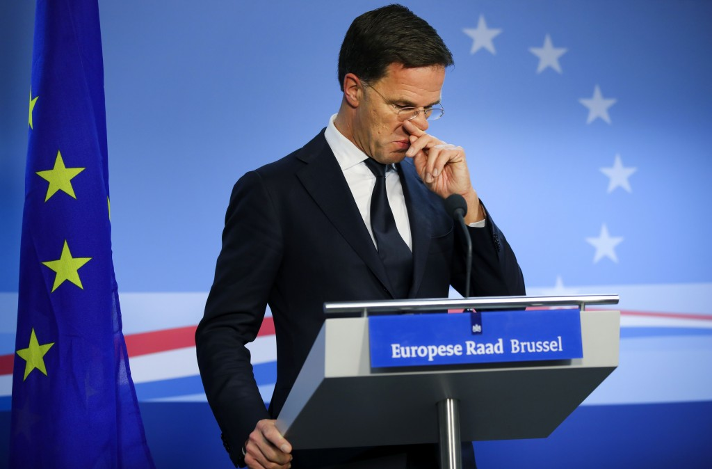 FILE - In this Friday, Feb. 21, 2020 file photo, Dutch Prime Minister Mark Rutte speaks during a media conference at the end of an EU summit in Brusse...