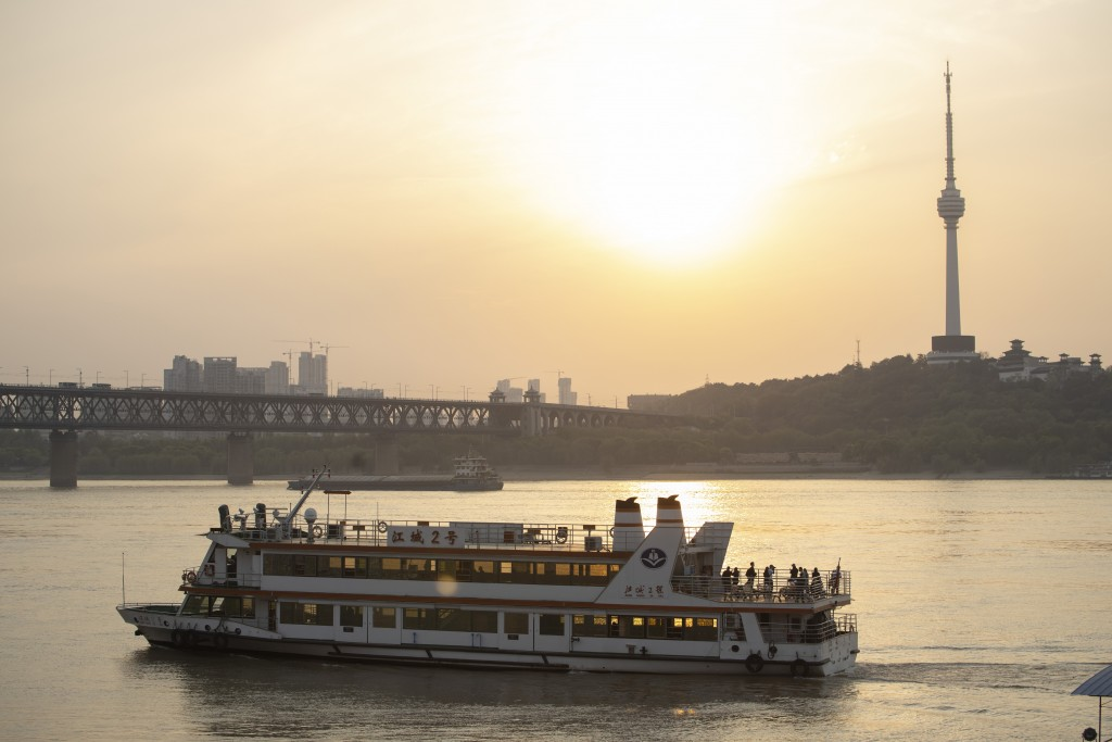 In this April 8, 2020, photo, a ferry crosses the Yangtze River in Wuhan in central China's Hubei province. The reopening of ferry service on the Yang...
