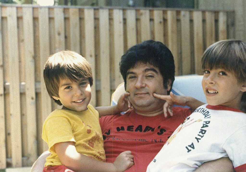 This circa 1987 photo provided by the family shows Isaiah Kuperstein with his sons, Daniel, left, and Adam in the Queens borough of New York. Isaiah K...