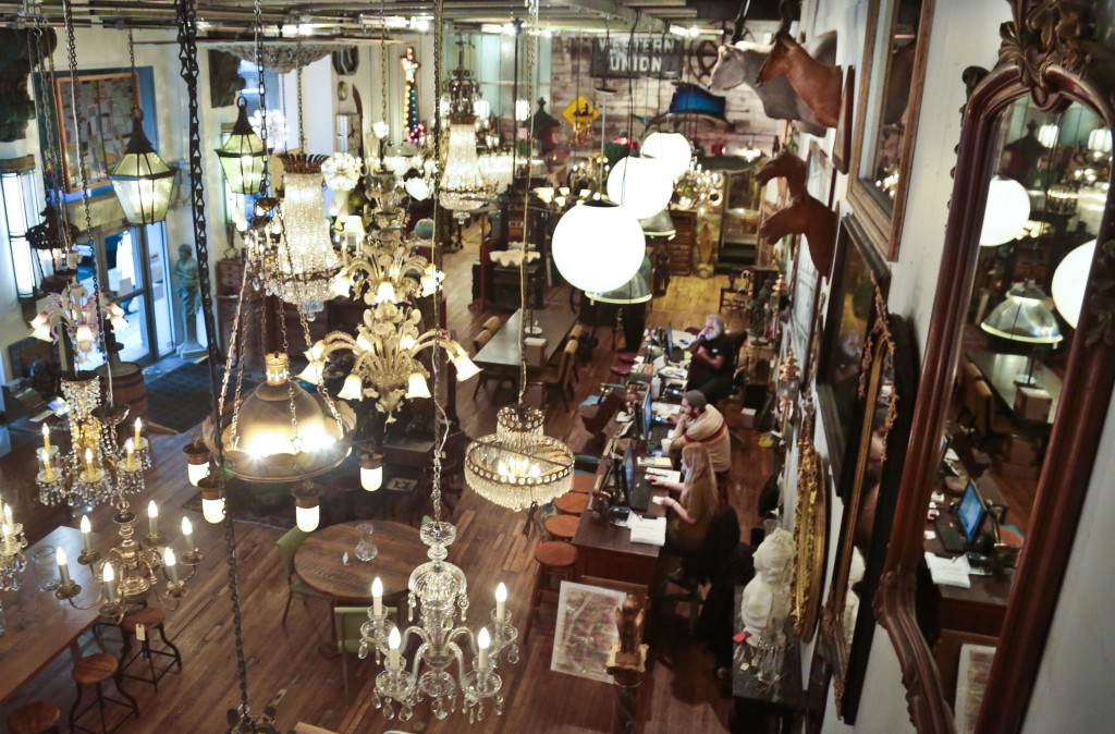 FILE - In this Nov. 22, 2013 file photo, rare chandeliers and light fixtures hang at the Olde Good Things antique store in New York, owned by the the ...