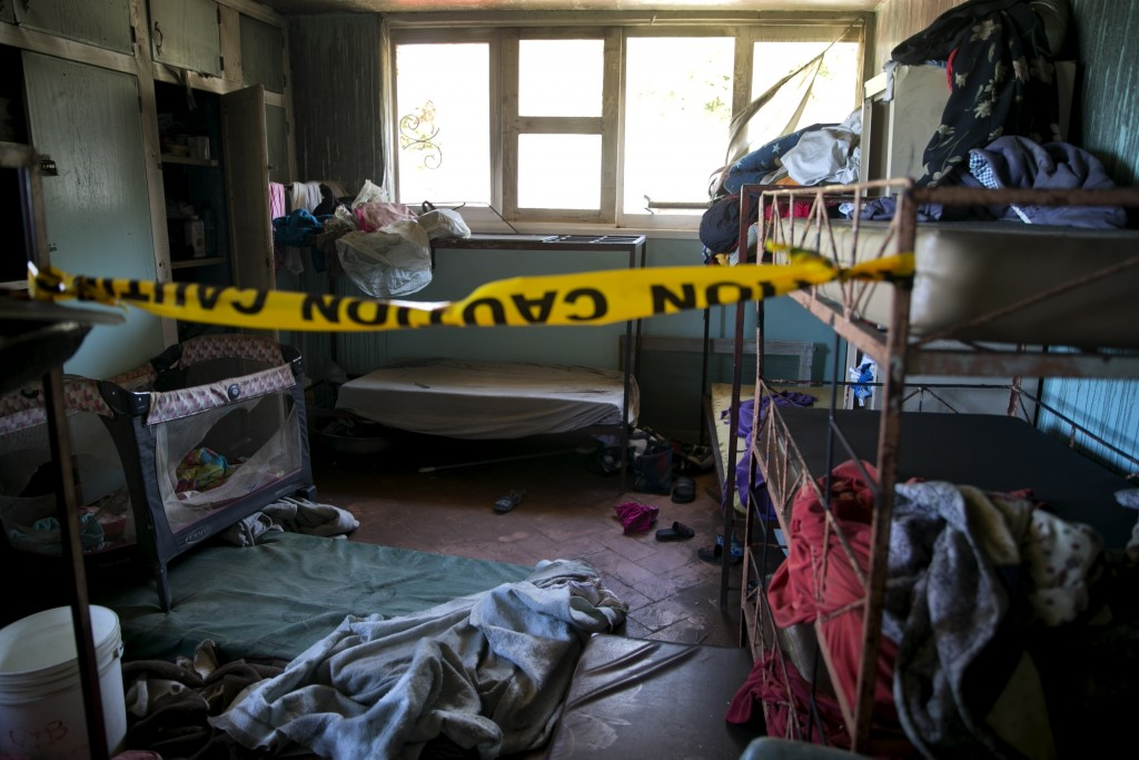 FILE - In this Feb. 14, 2020 file photo, police tape hangs inside an empty room at a children's home run by the Church of Bible Understanding (COBU) w...