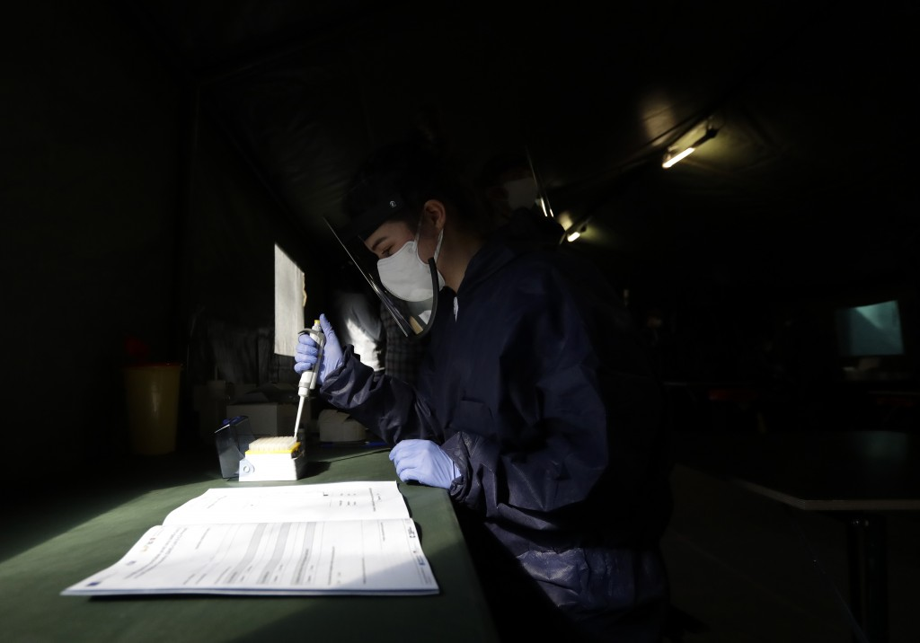 A healthcare worker conducts test for the coronavirus in Prague, Czech Republic.