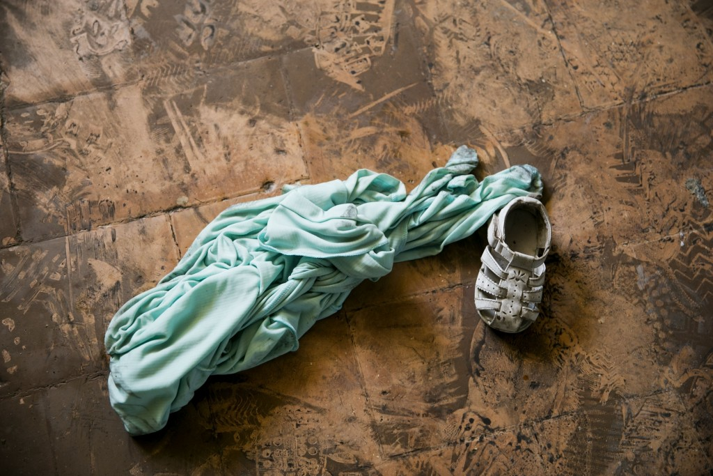 FILE - In this Feb. 14, 2020 file photo, a child's shoe and dress lay inside the children's home run by the Church of Bible Understanding (COBU) where...