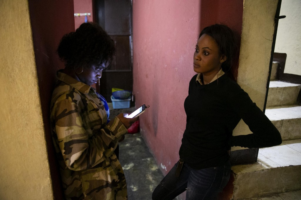 Anaika Francois, left, and Stephanie Victor, whose parents placed them in the children's home run by the Church of Bible Understanding (COBU) when the...