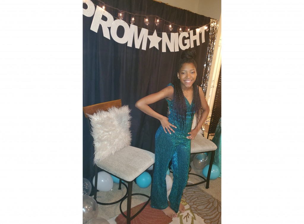 This photo shows Serenity Cadogan, 12, in Covington, Georgia, dressed for a virtual prom she hosted March 31 on National Prom Day for more than 600 yo...