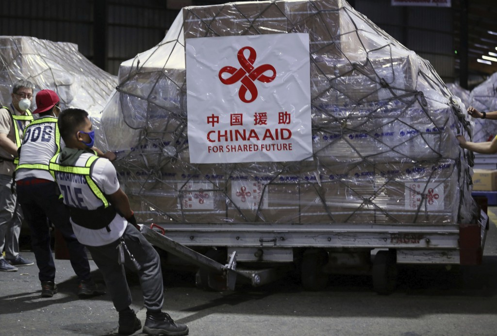 In this March 21, 2020, photo released by Xinhua News Agency, workers unload medical supplies donated by China at the Ninoy Aquino International Airpo...