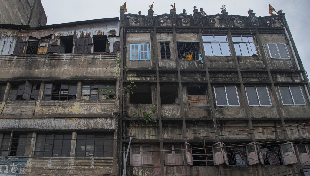 Indians look through the window of their house during nationwide lockdown in Gauhati, India, Thursday, April 23, 2020. As governments around the world...