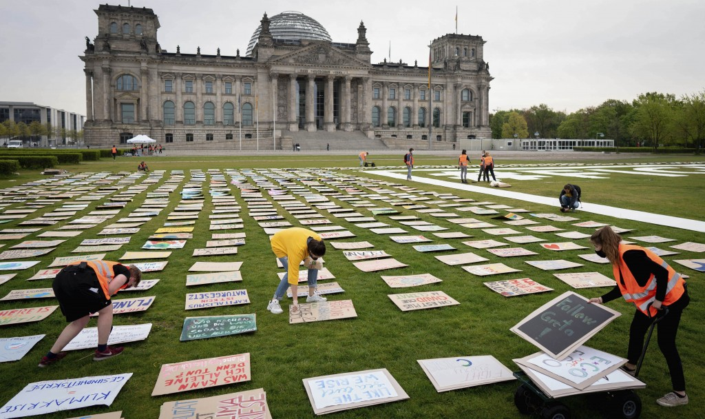 Activists of Fridays for Future movement placed protest posters for climate protection in front the German parliament building the Reichstag in Berlin...