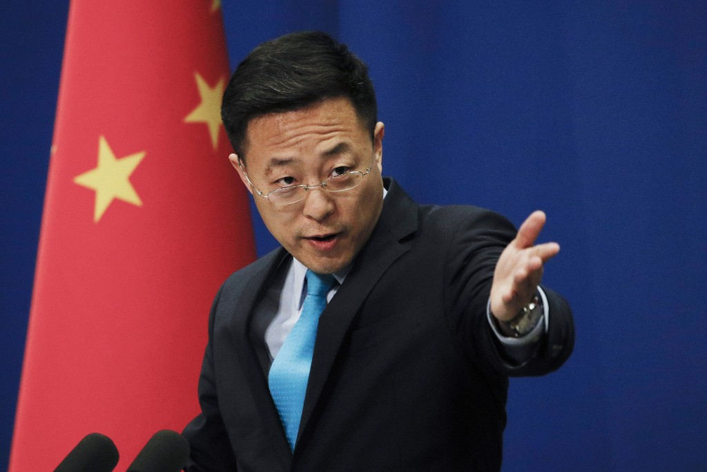 FILE - In this file photo taken Monday, Feb. 24, 2020, Chinese Foreign Ministry new spokesman Zhao Lijian gestures as he speaks during a daily briefin...