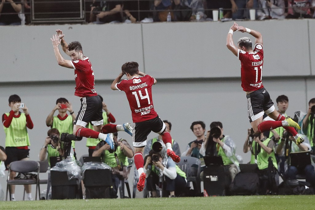 FILE - In this July 26, 2019, file photo, Cesinha, right, of Team K League jumps with his teammates to celebrate after scoring a goal against Juventus...