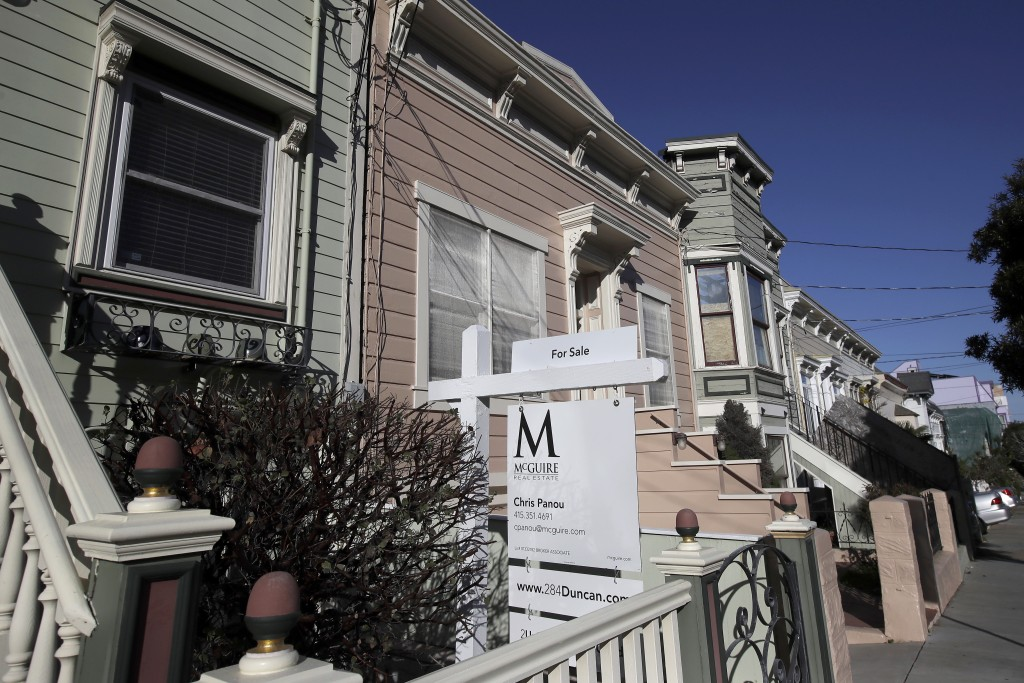 FILE - This Feb. 18, 2020, photo shows a real estate sign in front of a home for sale in San Francisco.  An estimated 4.1 million Americans have their...
