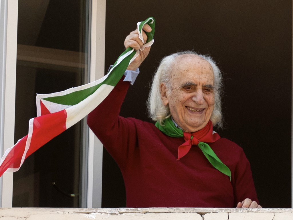 Former partisan Massimo Pradella, 96,  poses at his window in Rome, Friday, April 24, 2020. On April 25 every year Italy celebrates the end of the Naz...