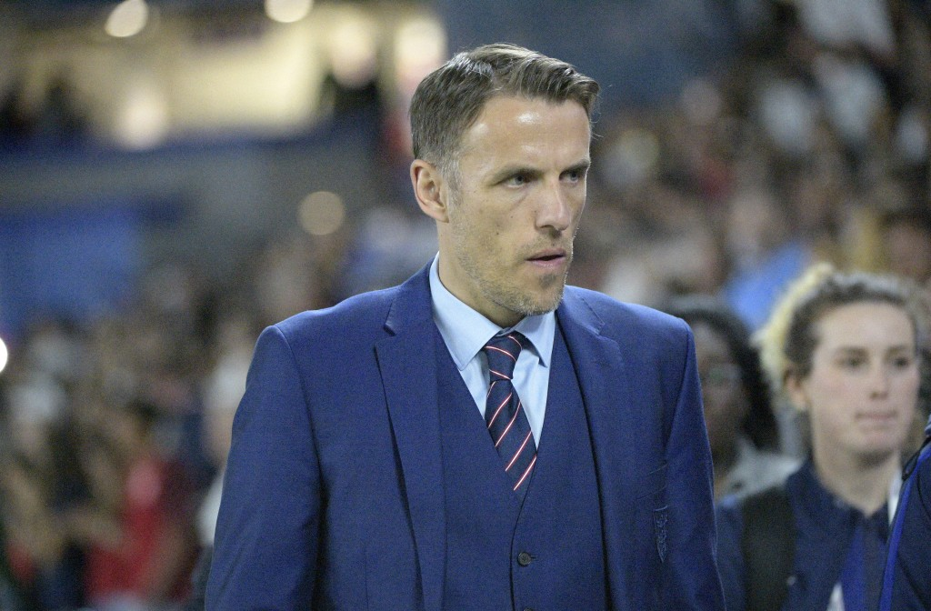 FILE - In this file photo dated Wednesday, March 7, 2018, England head coach Phil Neville walks onto the field before a SheBelieves Cup women's soccer...