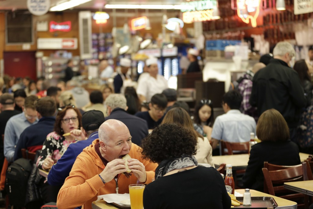 FILE - In this May 11, 2017, file photo, diners enjoy eating at Katz's Delicatessen in New York. With New York City at the epicenter of the coronaviru...