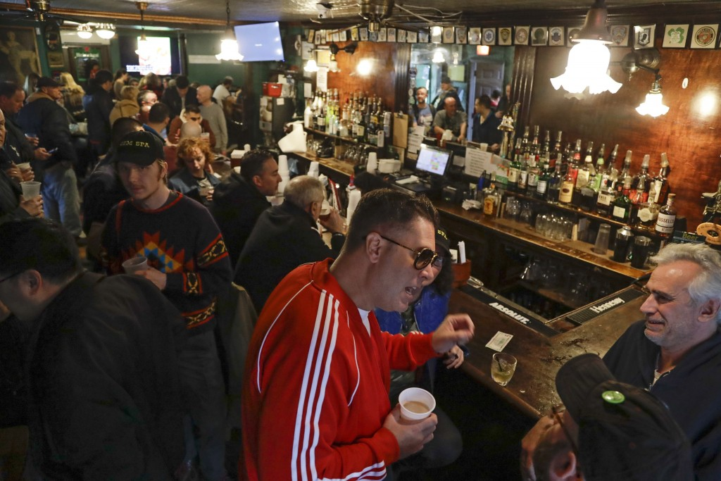 FILE- In this Jan. 11, 2020, file photo, patrons gather at Neir's Tavern in the Queens borough of New York. With New York City at the epicenter of the...