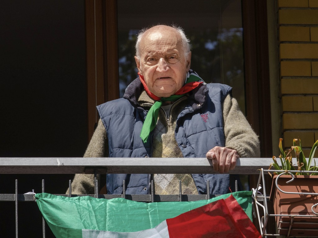 Former partisan Guido Ravenna, nicknamed 'Furio', 92, poses at his window in Milan, Italy, Friday, April 24, 2020. On April 25 every year Italy celebr...