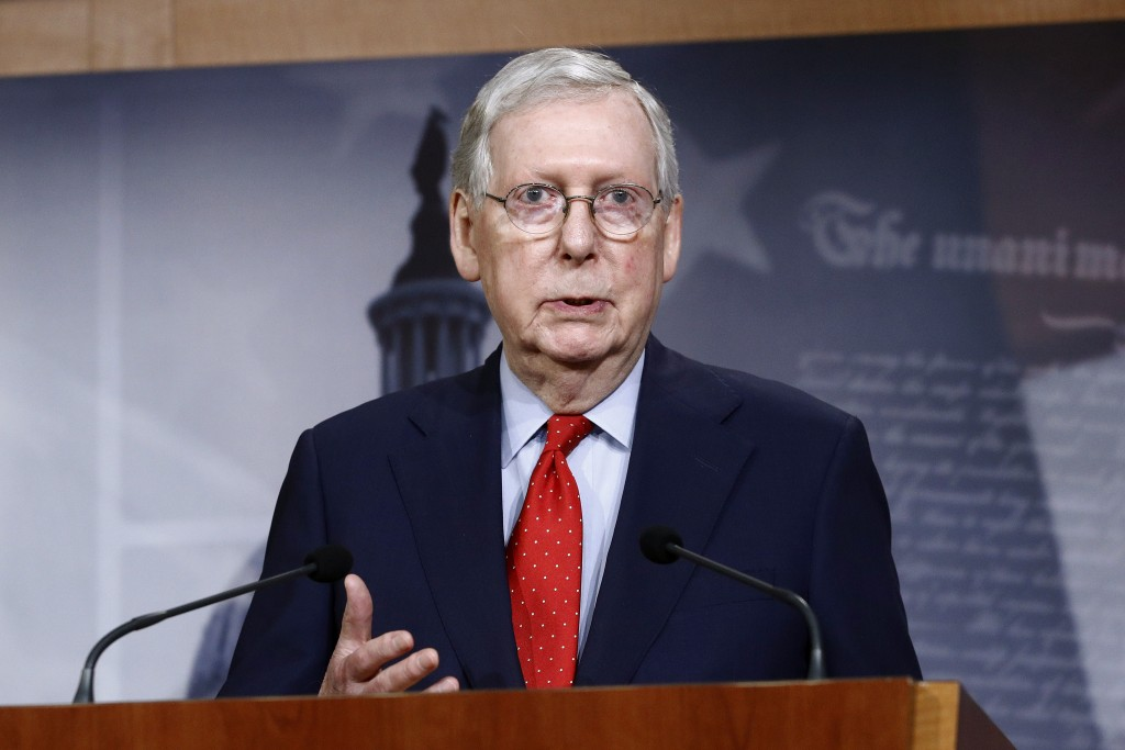 FILE - In this April 21, 2020, file photo Senate Majority Leader Mitch McConnell of Ky., speaks with reporters after the Senate approved a nearly $500...