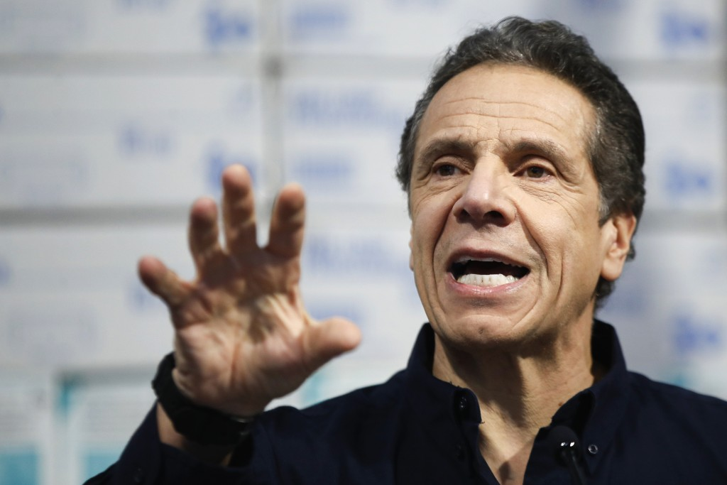 FILE- In this March 24, 2020, file photo, New York Gov. Andrew Cuomo speaks during a news conference at the Jacob Javits Center in New York. With New ...