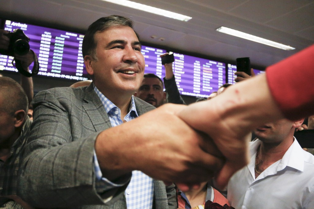 FILE - In this Wednesday, May 29, 2019 file photo, Georgia's ex-President Mikheil Saakashvili, greets his supporters upon his arrival at Boryspil Airp...