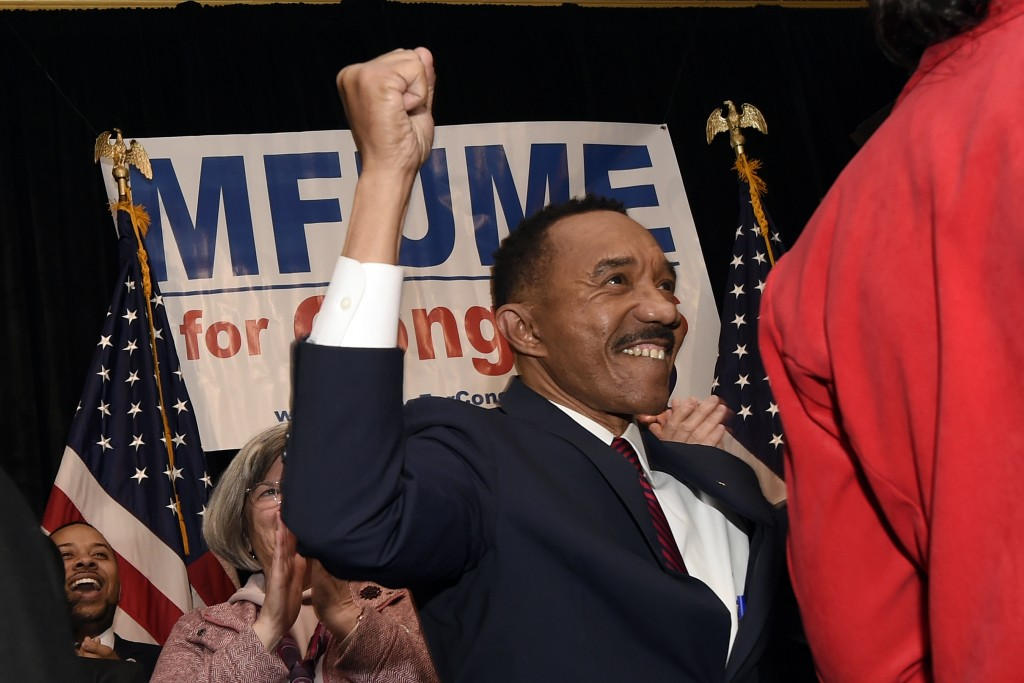 FILE - In this Feb. 4 2020 file photo, Kweisi Mfume, Democratic nominee for Maryland's 7th Congressional District, raises his fist at a victory party ...