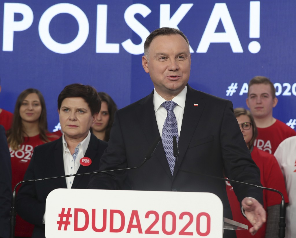 FILE - In this file photo taken Feb. 19, 2020, Poland's President Andrzej Duda, center, campaigning for his re-election in Warsaw, Poland.  The Polish...