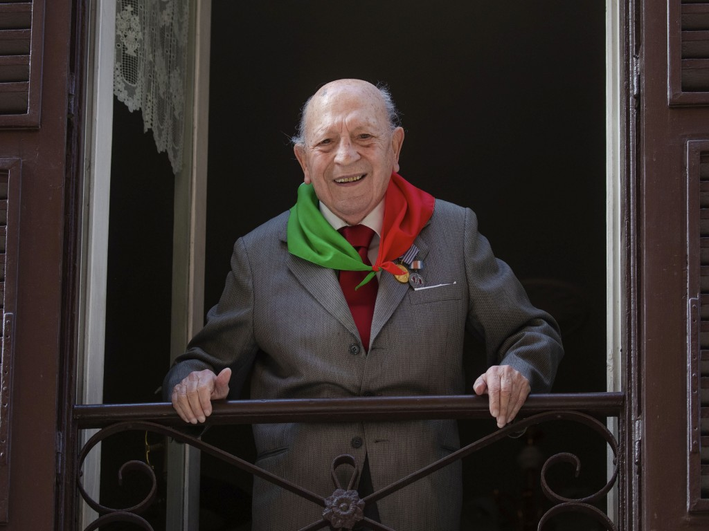 Former Partisan Umberto Graziani, 96, poses at his window in Rome, Thursday, April 23, 2020. On April 25 every year Italy celebrates the end of the Na...
