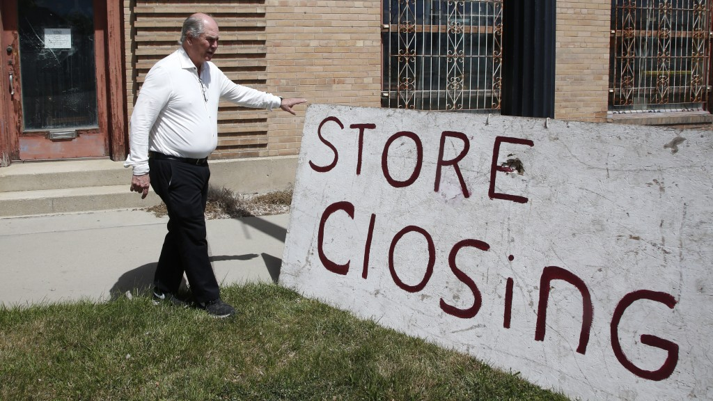 Euro Treasures Antiques owner Scott Evans stands next to the store closing sign outside of his business Friday, April 24, 2020, in Salt Lake City. Eva...