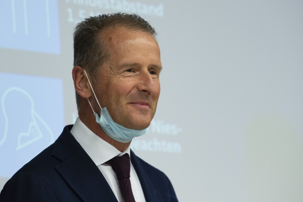 FILE - In this Monday, April 27, 2020. file photo, Volkswagen CEO Herbert Diess wears a face mask as he attends the restart of the production at the V...