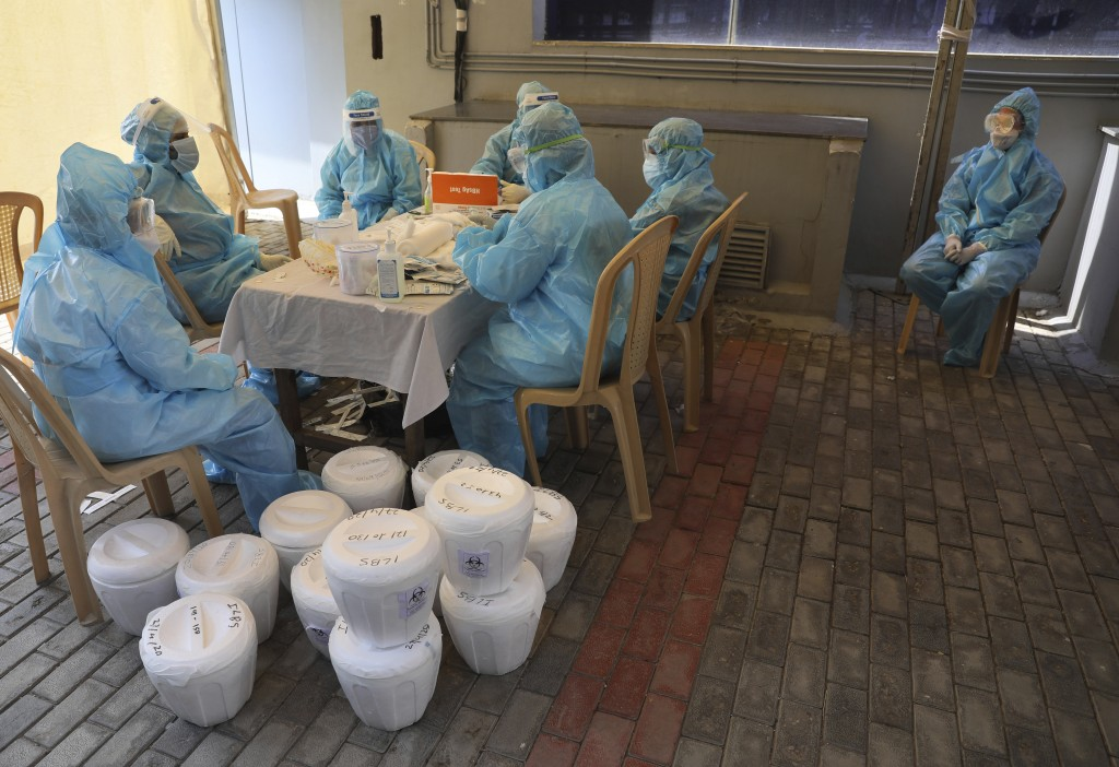 Indian health workers organize the samples at a COVID-19 testing center in New Delhi, India, Monday, April 27, 2020. India's main medical research org...
