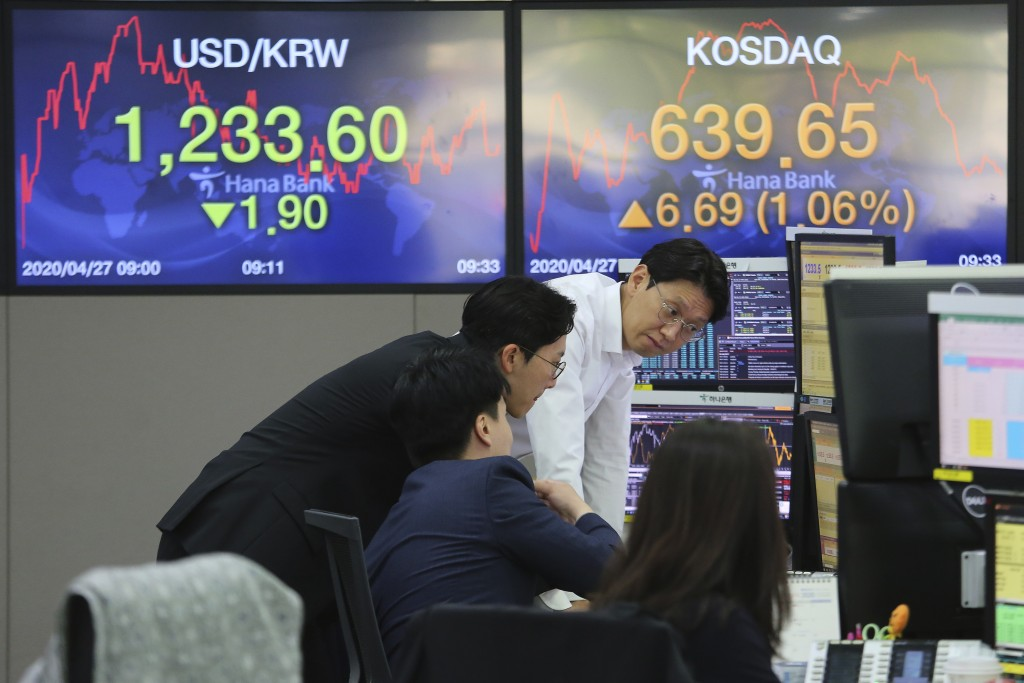 Australia: Shares close higher on global stimulus hopes