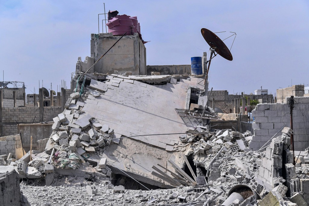 This photo released by the Syrian official news agency SANA, shows the rubble of a house that according to the Syrian authorities was attacked by an I...