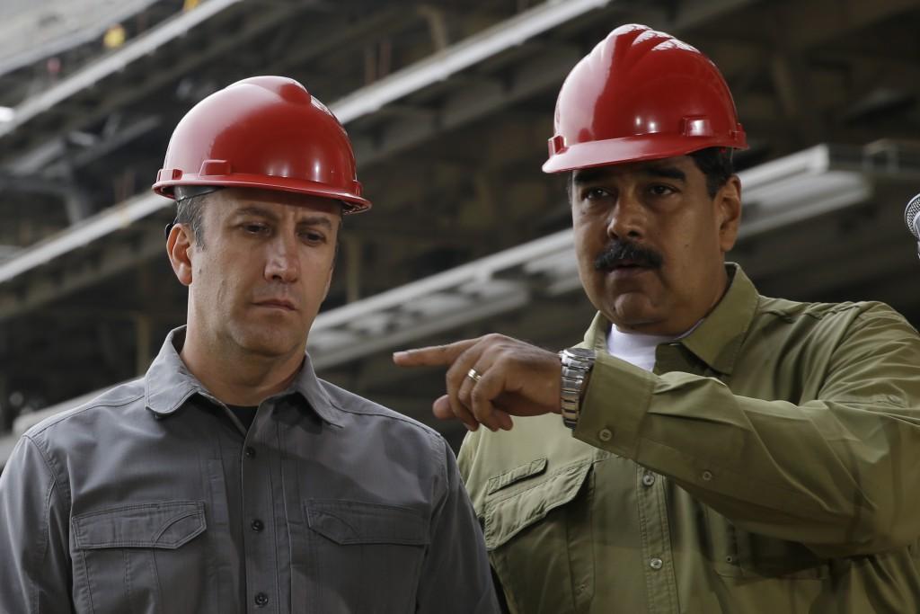 FILE - In this May 19, 2018 file photo, Venezuela's President Nicolas Maduro, right, and Vice President Tareck El Aissami tour La Rinconada baseball s...