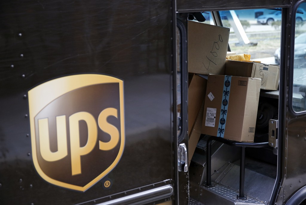 FILE - In this Dec. 19, 2018, file photo packages await delivery inside of a UPS truck in Baltimore. United Parcel Service Inc. reported a 13% drop in...