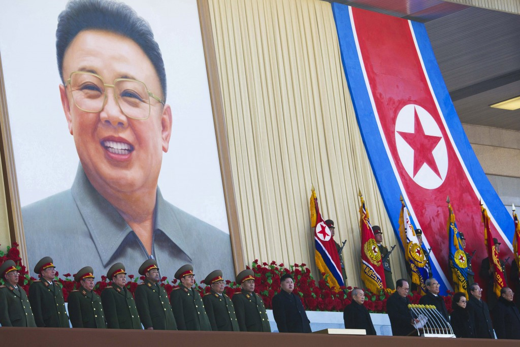 FILE - In this Feb. 16, 2012, file photo, new North Korean leader Kim Jong Un, center, and senior political and military leaders stand at attention at...