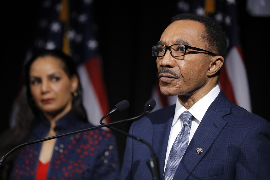 Democrat Kweisi Mfume, right, speaks as his wife, Tiffany Mfume, looks on during an election night news conference at his campaign headquarters after ...