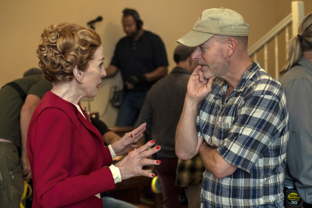 """This image released by Netflix shows actress Holland Taylor, left, speaking with Ryan Murphy on the set of """"Hollywood.""""  The series premieres May 1 on..."""