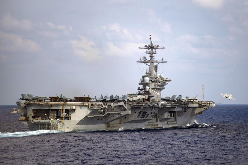In this March 18, 2020, photo provided by the U.S. Navy, an F/A-18F Super Hornet launches from the flight deck of the aircraft carrier USS Theodore Ro...