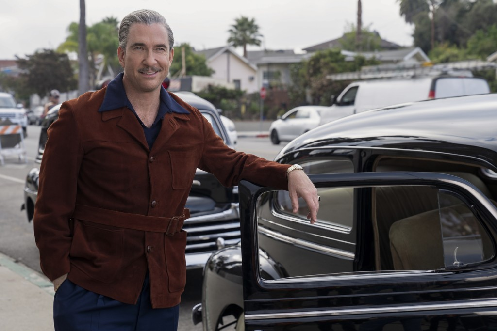 """This image released by Netflix shows Dylan McDermott in a scene from """"Hollywood"""" premiering May 1 on Netflix. (Saeed Adyani/Netflix via AP)"""