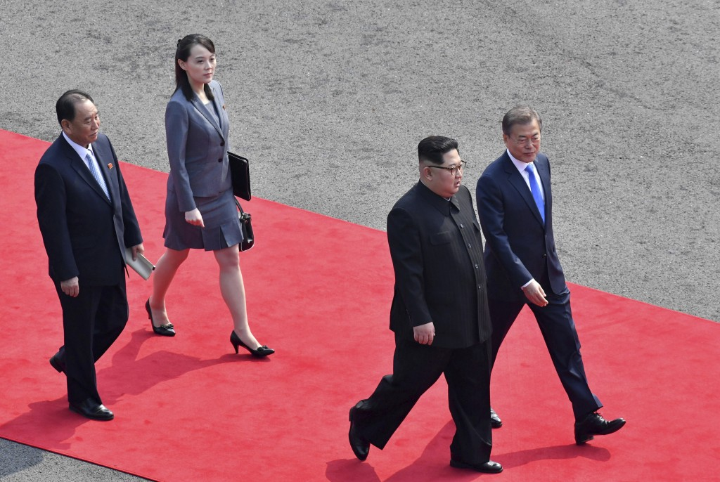 FILE - In this April 27, 2018, file photo, North Korean leader Kim Jong Un, second from right, walks with South Korean President Moon Jae-in, right, f...