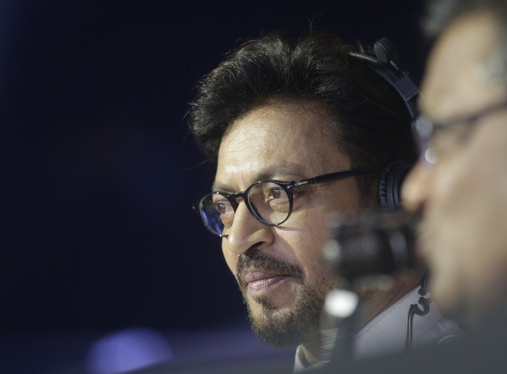FILE- In this Oct. 23, 2017 file photo, Bollywood actor Irrfan Khan watches a Vivo Pro Kabaddi league match in Mumbai, India. Khan, a veteran characte...