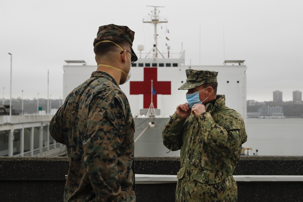 The USS Naval Hospital Ship Comfort sits in the harbor before departing, Thursday, April 30, 2020, in the Manhattan borough of New York. (AP Photo/Joh...